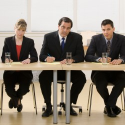 Panel of co-workers about to conduct a job interview